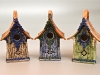 three birdhouses in different colors